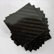 Commercial sample carbon fiber plate one side - 50 x 50 x 1.5 mm.