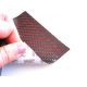 Commercial sample flexible carbon fiber sheet with colored silk (Color Black and Red) with 3M adhesive - 50x50 mm.