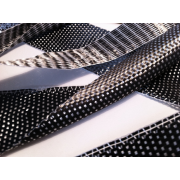 FLAT CARBON FIBER TAPE FOR STRUCTURAL REINFORCEMENTS OF COMPOSITE PARTS MADE WITH RESINS